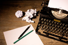 http://www.dreamstime.com/royalty-free-stock-images-vintage-typewriter-blank-sheet-paper-image35272689